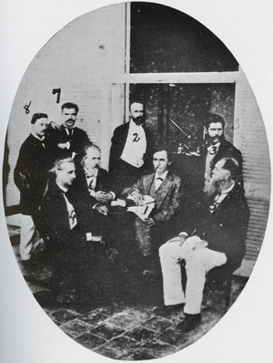 The Havana Yellow Fever Commission of the United States National Board of Health. This photograph was taken at the Commission's laboratory in Havana's Hotel San Carlos in August 1879. (Left to Right) Abraham Morejon, Assistant Medical Clerk; Colonel Thomas S. Hardee, Sanitary Engineer; Rudolph Matas, Medical Clerk; Henry C. Hall, U.S. Consul General at Havana; George M. Sternberg, Bacteriologist; Stanford E. Chaille, Chairman; Juan Guiteras y Gener, Pathologist; Daniel Burgess, U.S. Sanitary and Quarantine Inspector at Havana. Photograph taken from: Finl;ay, Carlos Eduardo. Carlos Finlay and Yellow Fever. New York: Oxford University Press, 1940. pg. 55.